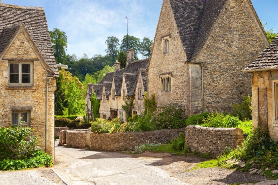Scenic view on old street in sunny morning , Bibury, Gloucestershir, England, UK.